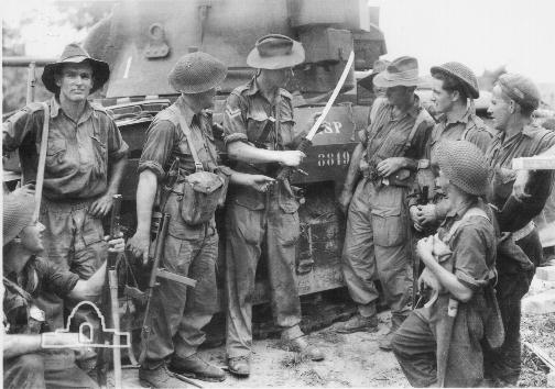 Corporal Peter Teague, 1 Armoured Regiment, showing the Japanese sword which he captured