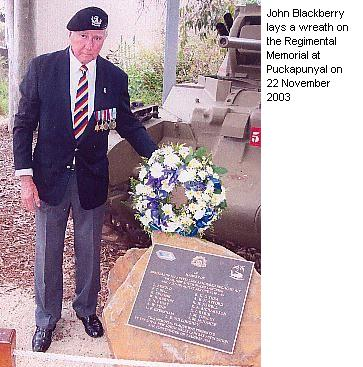 John Blackberry lays a wreath on the Regimental Memorial at Puckapunyal on 22 November 2003