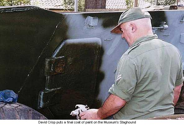 David Crisp puts a final coat of paint on the Museum's Staghound