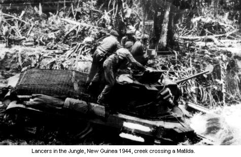 A Matilda Tank crosses a creek in New Guinea